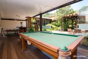 A pool table at Hotel La Forêt & Beach Club