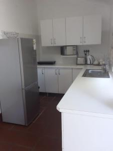 A kitchen or kitchenette at St Lucia Eco Lodge