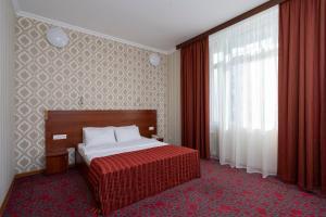 Кровать или кровати в номере Отель Регина на Петербургской