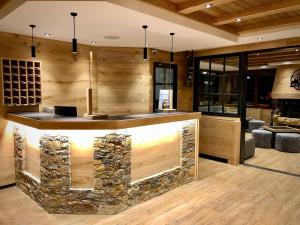 The lobby or reception area at Hotel Petit Lacreu