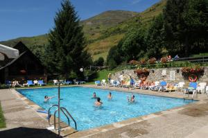 The swimming pool at or near Hotel Petit Lacreu