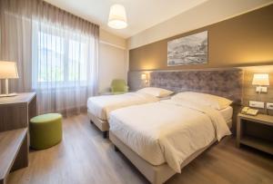 Ein Bett oder Betten in einem Zimmer der Unterkunft Hotel Unione