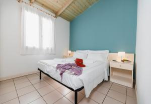 A bed or beds in a room at Natural Village Resort