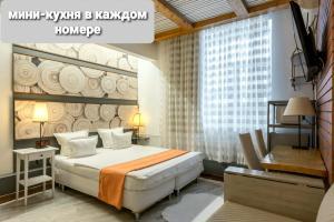 Кровать или кровати в номере Hotel Wood Street (Hotel On 5 Floor)