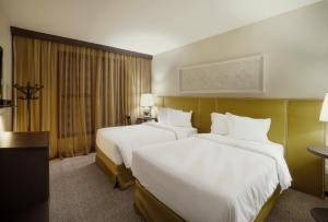 A bed or beds in a room at Ouro Minas Palace Hotel
