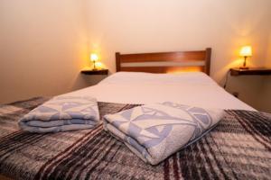 Cama ou camas em um quarto em Pousada Rosa dos Ventos