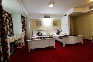 Кровать или кровати в номере Hotel Helin Central