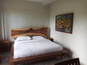 Een bed of bedden in een kamer bij Jiwa Jawa Resort Ijen