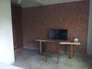 Een TV en/of entertainmentcenter bij Jiwa Jawa Resort Ijen
