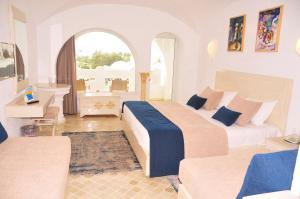 Кровать или кровати в номере HOTEL LELLA BAYA