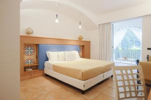 A bed or beds in a room at Tenuta Moreno