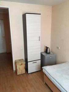Кровать или кровати в номере Гостиница Рассвет