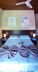 A bed or beds in a room at Vento Sul