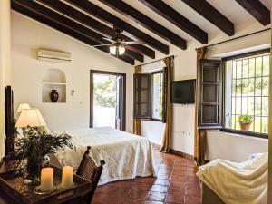 Cama o camas de una habitación en La Fuente del Sol Hotel & Spa
