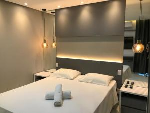 A bed or beds in a room at Flat Crystal Place
