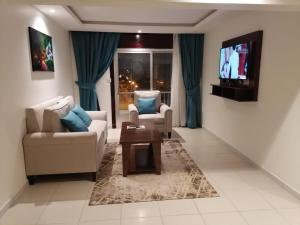Uma área de estar em ِAl Morabaa Hotel