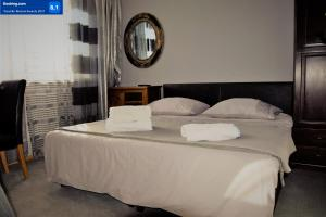 A bed or beds in a room at Villa Asesor