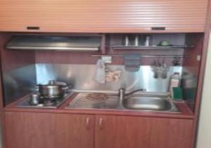 Кухня или мини-кухня в Hotel Fotini
