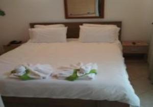 Кровать или кровати в номере Hotel Fotini
