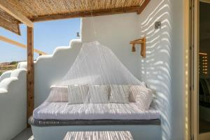 A bed or beds in a room at Pangaia Seaside Ηotel