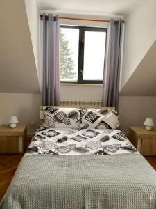"""Łóżko lub łóżka w pokoju w obiekcie Apartamenty """"Ach To Tu"""""""