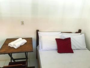 A bed or beds in a room at suíte prime centro vila do abrãao