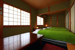 A bed or beds in a room at Miyoshino Sakuraan