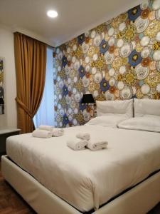 A bed or beds in a room at Hotel Cinquantatre