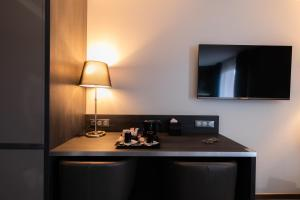 A television and/or entertainment centre at Mercure Bale Mulhouse Aeroport