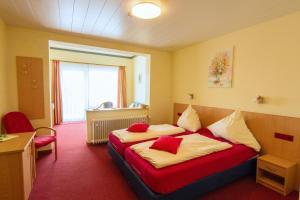 Ein Bett oder Betten in einem Zimmer der Unterkunft Schröder's Hotelpension