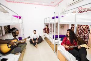 A bunk bed or bunk beds in a room at Musafir Hostel