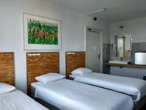 A bed or beds in a room at Hotel Verdi
