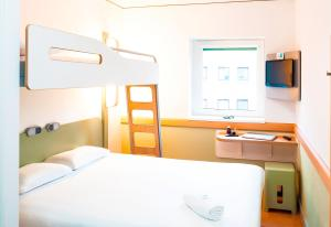 A bunk bed or bunk beds in a room at ibis budget Sheffield Arena