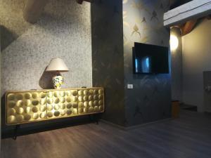 Télévision ou salle de divertissement dans l'établissement Hotel Centrale