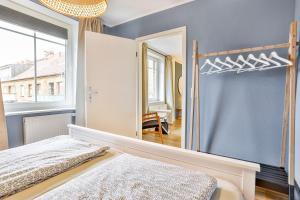 Ein Bett oder Betten in einem Zimmer der Unterkunft Ferienwohnungen im Bürgermeisterviertel