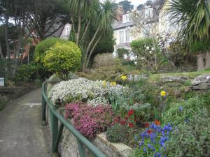 Un jardín fuera de Bron Orme Private Hotel