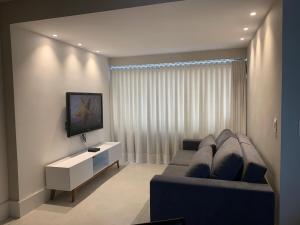 A seating area at Apartamento Novo no Centro de BH, Ar Cond, WiFi, Garagem