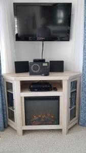 A television and/or entertainment center at Blue Waters Cottage