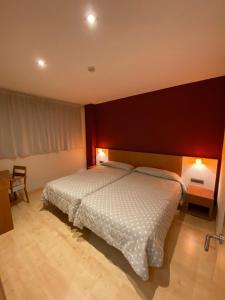 Cama o camas de una habitación en Apartamentos Dream Park