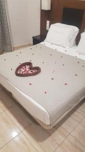 A bed or beds in a room at City Hotel Alger