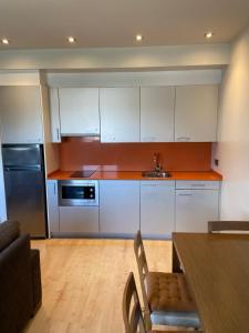 Una cocina o zona de cocina en Apartamentos Dream Park