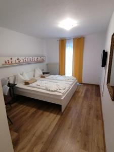 A bed or beds in a room at Boutique hotel Pohorje