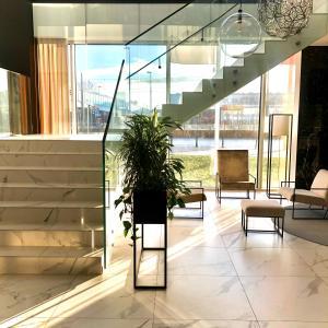 The lobby or reception area at Arche Hotel Krakowska