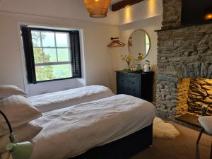 A bed or beds in a room at The Hafod Hotel