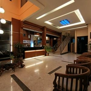 The lobby or reception area at Omah Qu Guesthouse Malioboro