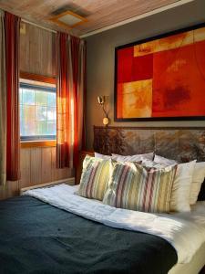 Säng eller sängar i ett rum på Joängets Fjällgård