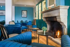 A seating area at SOWELL HOTELS Le Beach