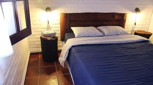 A bed or beds in a room at Cabañas NUBA