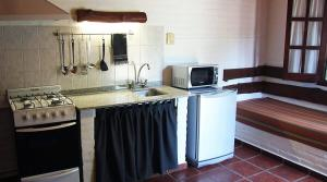A kitchen or kitchenette at Cabañas NUBA
