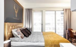 Vuode tai vuoteita majoituspaikassa Trendy Homes Oulu Marski Apartments